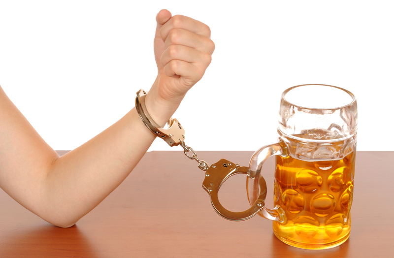 handcuffed_to_alcohol_drink